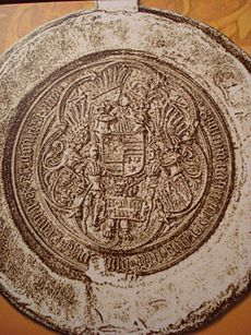 A seal depicting three coat of arms held by two armored men
