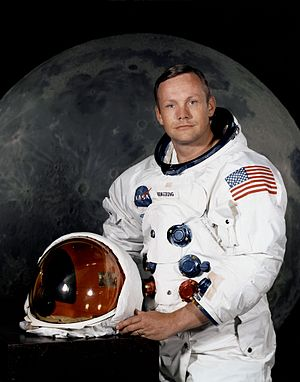 Photo of Neil Armstrong, July 1969, in space suit with the helmet off