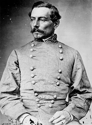 Head and torso photograph of a high ranking Confederate army officer. He has short dark hair, a mustache, and small goatee