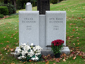 "A twin gravestone bearing the name ""Frank O'Connor"" on the left, and ""Ayn Rand O'Connor"" on the right"