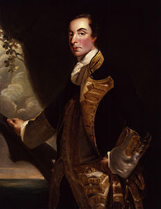 A three-quarter-length portrait of Admiral Rodney in relative youth.  He stands before a mostly dark background; his right hand rests on what looks like a large tree branch, behind which the sea is visible.  He wears a dark coat with gold embroidery over a white waistcoat.