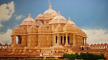 A complete view of Akshardham temple with people entering the temple