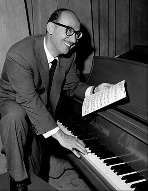 Sammy Cahn playing a piano.