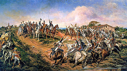 A painting depicting a group of uniformed men on horseback riding towards a smaller group of mounted men who have halted at the top of a small hill with the uniformed man at the front of the smaller group raising a sword high into the air