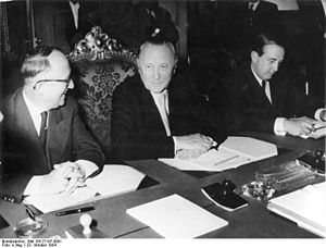 Walter Hallstein, Konrad Adenauer and Herbert Blankenhorn sitting at a conference table