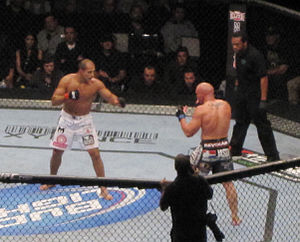 Junior dos Santos, in white shorts, and Shane Carwin, in black shorts, during an MMA fight at the main event of UFC 131 in Vancouver, British Columbia, on June 11, 2011.