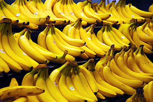 Grocery store photo of several bunches of bananas
