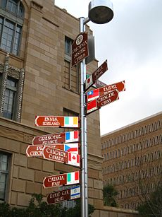 photo of signpost with ten signs pointing in the direction of Phoenix's sister cities, stating their names and distances from Phoenix.