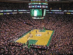 Professional basketball game between the Celtics and Timberwolves in a crowded arena