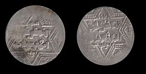 Front and back of a coin, with six-pointed stars