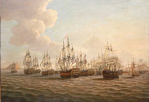 The painting focuses on the morning after the battle when British ships surrounded the fleeing Spanish fleet. The scene is bathed in a golden glow of early morning light. The British flagship is in the centre, indicated by the flag flying from the mainmast. She is at the head of a line of British ships, shown in the act of capturing the Spanish squadron in the middle centre. Land can be seen in the distance on the left.