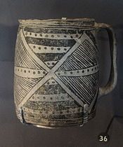 A color picture of a black-on-white pottery vessel