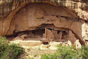 A color picture of a large sandstone cliff dwelling