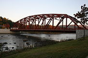 A small metal Parker truss bridge