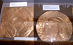 two replica repousse copper plates from Spiro