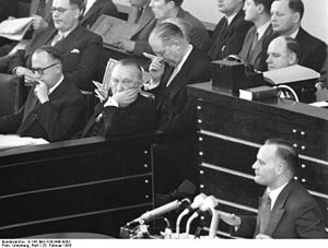 Walter Hallstein sitting with Konrad Adenauer in the Bundestag; Karl Mommer speaking
