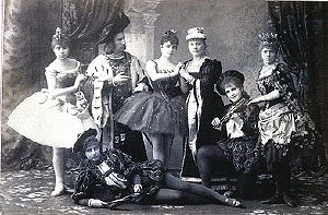 A group of ballet dancers dressed in 17th-century costumes.