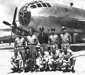 Formal picture of ten men in uniform. Five are standing and five are kneeling. In contrast to the Enola Gay picture, all are in correct uniform. The five standing are wearing ties, and all but one of the ten wears a peaked cap or garrison cap.