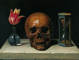 Symbols of death in a painting: it shows a flower, a skull and an hourglass