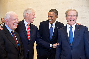 Portrait of four presidential men in dark suits and ties