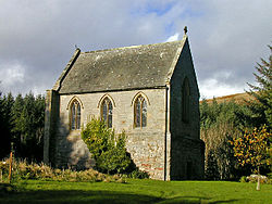 A short, relatively tall chapel, with three arched windows in the near face, and a taller similar window in the face receding to the right