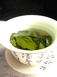 Tea leaves steeping in zhong caj