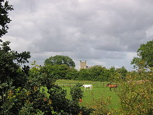 An English pastoral scene, with horses and a church in the background