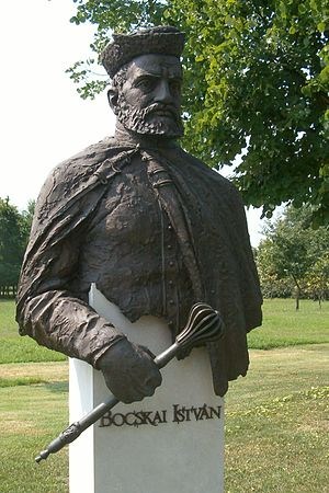 Statue of bearded man with hat, holding a scepter