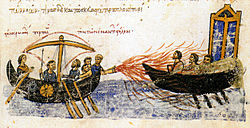 Medieval miniature depicting a sailing vessel discharging fire on another boat through a tube