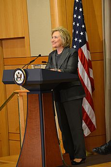 Clinton standing behind lectern