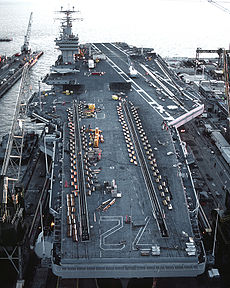 Abraham Lincoln in drydock. Equipment and vehicles are on deck for the overhaul