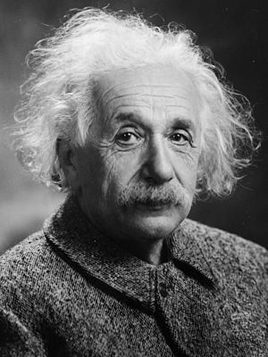 A photograph of Albert Einstein, with flowing, white hair